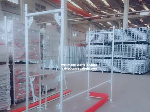 https://www.wm-scaffold.com/wp-content/uploads/2020/11/Layher-Scaffolding-Facade-Scaffold-Construction-Speedy-Frame-System-.jpg